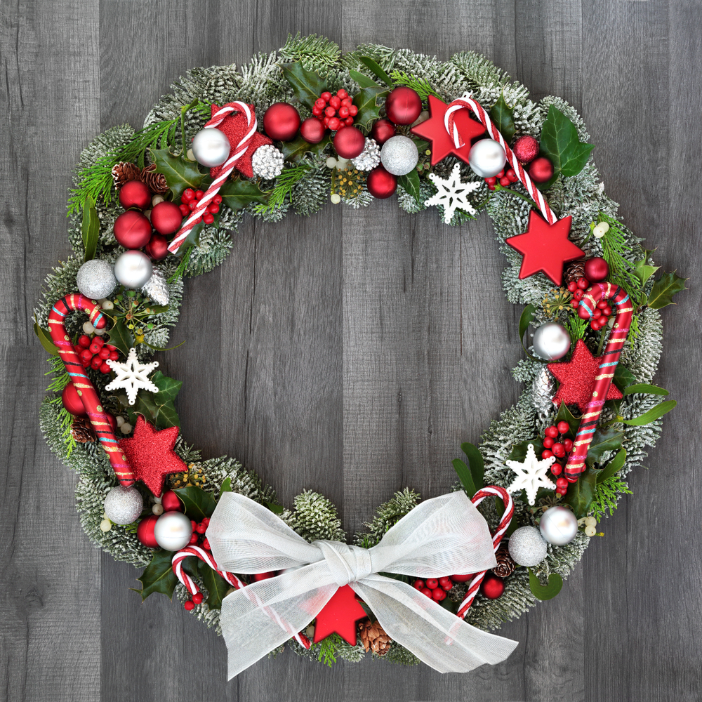 If you're looking for your next craft project, try one of these candy cane crafts. This wreath with candy canes on it is so cute and easy to make.