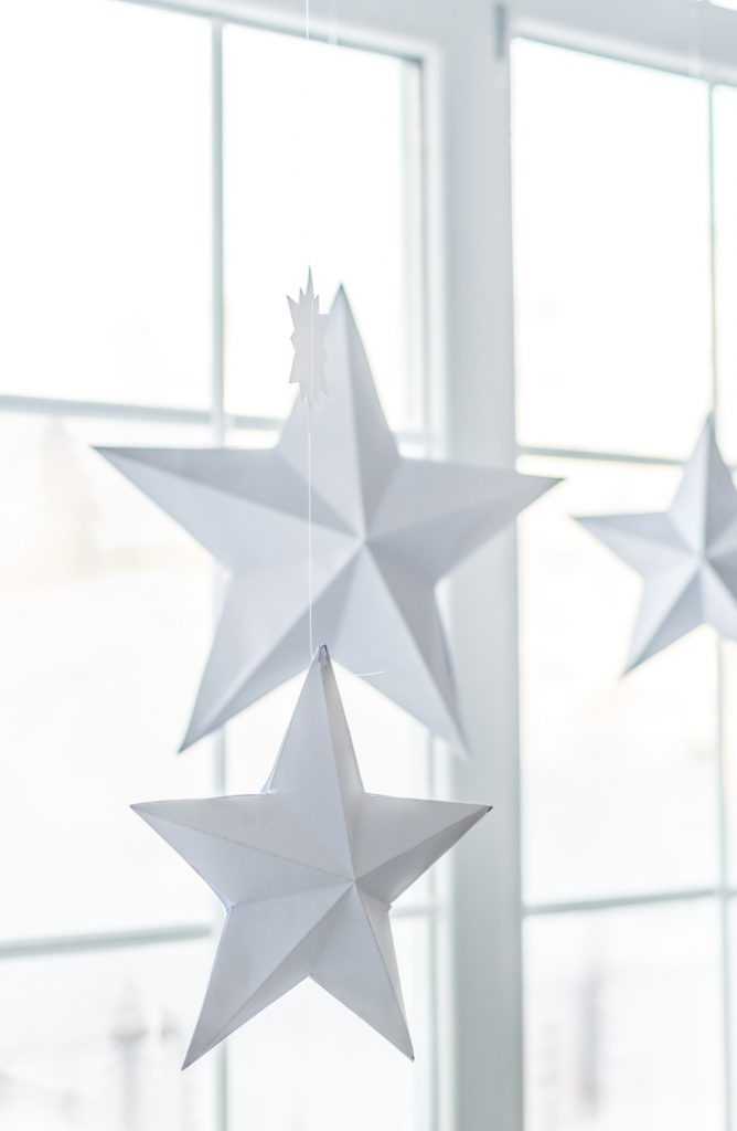 Hanging ornaments from your window is a cute way to decorate your window this holiday season. Look here for more Christmas window decor ideas.