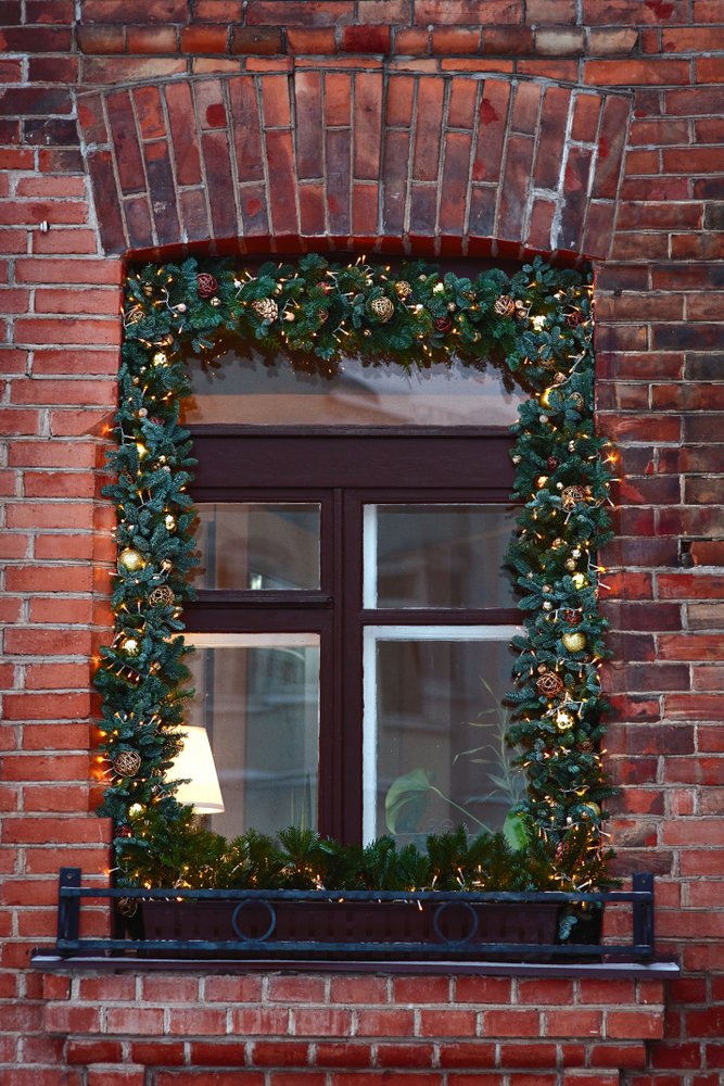 There is something so charming about having garland around your windows during the holidays. For more Christmas window decor ideas, look here!