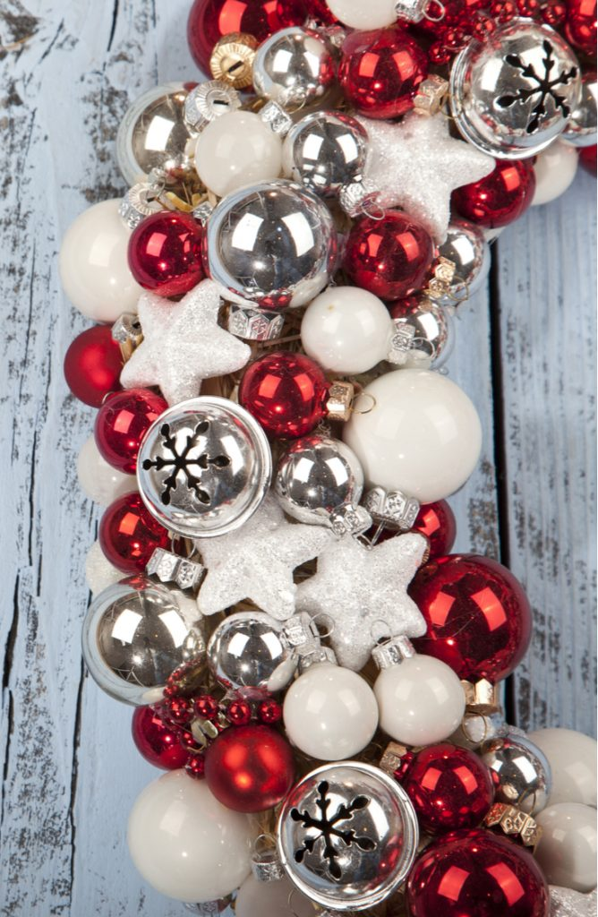 If you like the idea of having candy cane home decor, but want to make your own candy cane crafts, try making this candy cane ornament wreath. Everyone will love it.