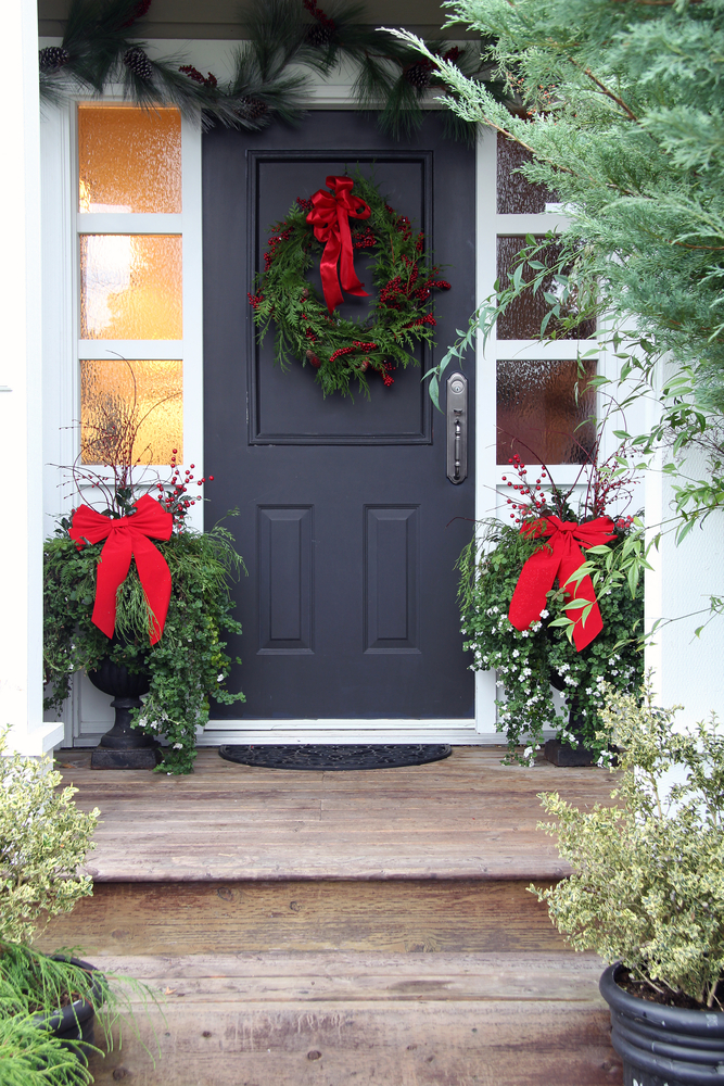 A cute wreath and bows goes a long way when decorating your porch for Christmas. For more Christmas porch decorating ideas, look here!