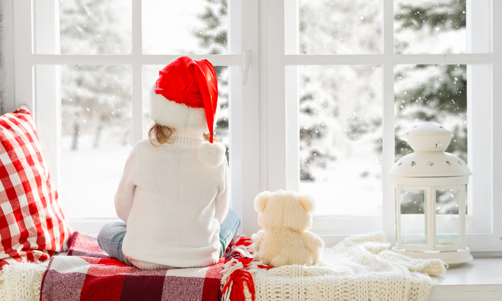 Creating a cozy place by the window to sit and watch snow is one of my favorite things to do. Check out my post for more Christmas window decor ideas.