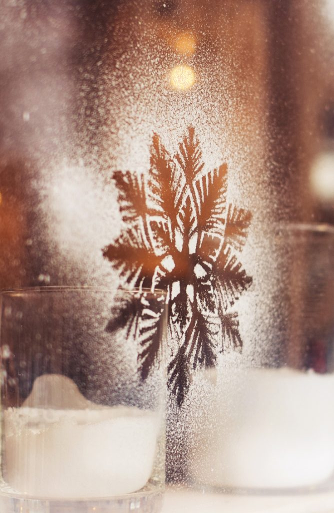 Painting windows with snowflake and other winter designs is one of my favorite things to do in the winter. For more Christmas window decor ideas, read my post!