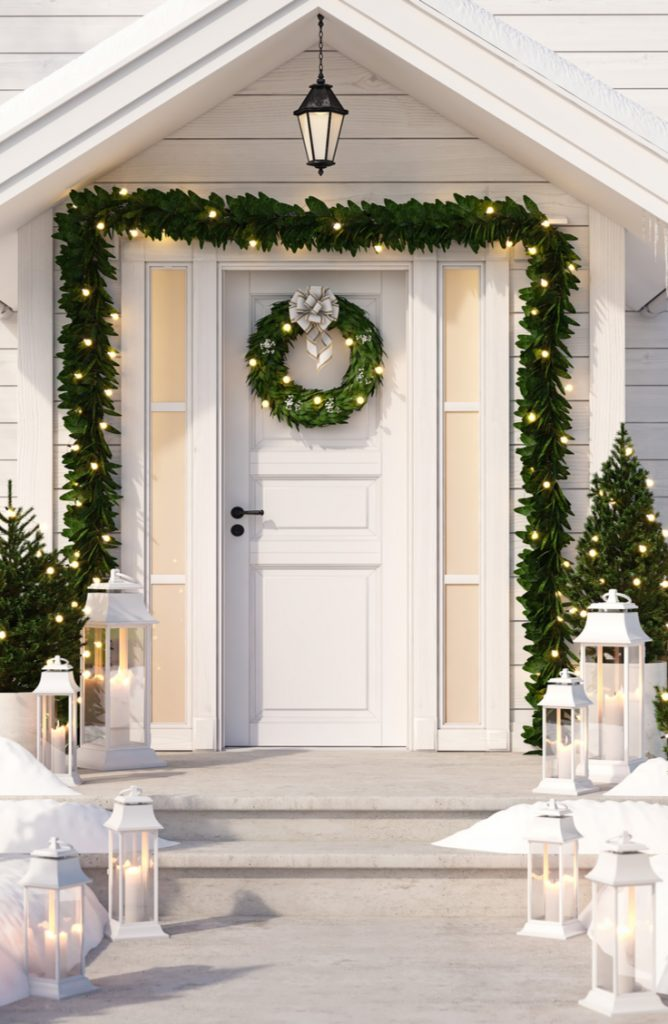 When decorating your porch for Christmas, it can be as simple as garland and lanterns. For more Christmas porch decorating ideas, look here!