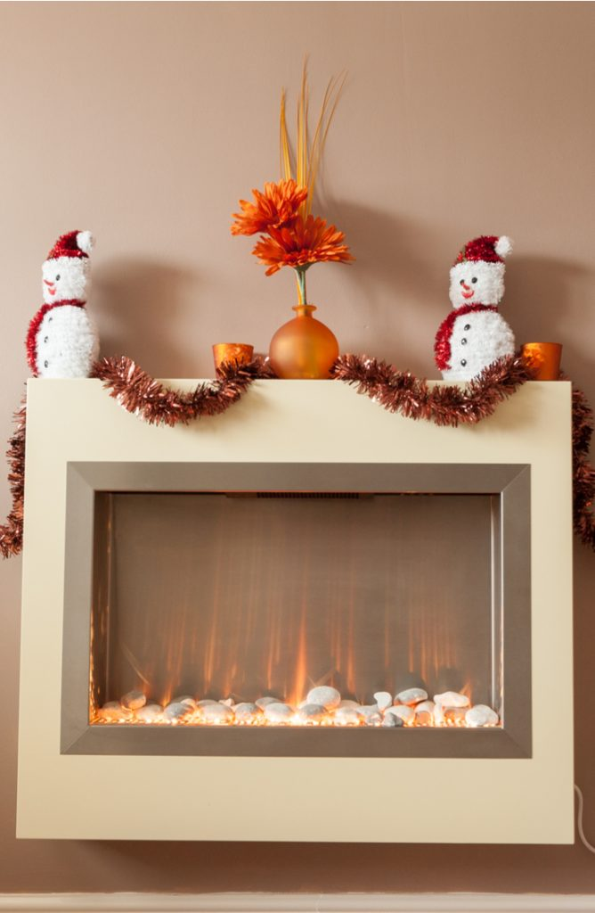 Sometimes it's hard to decorate for the holidays if you live in a modern home. These mantel Christmas decor ideas will fit any style and look good!
