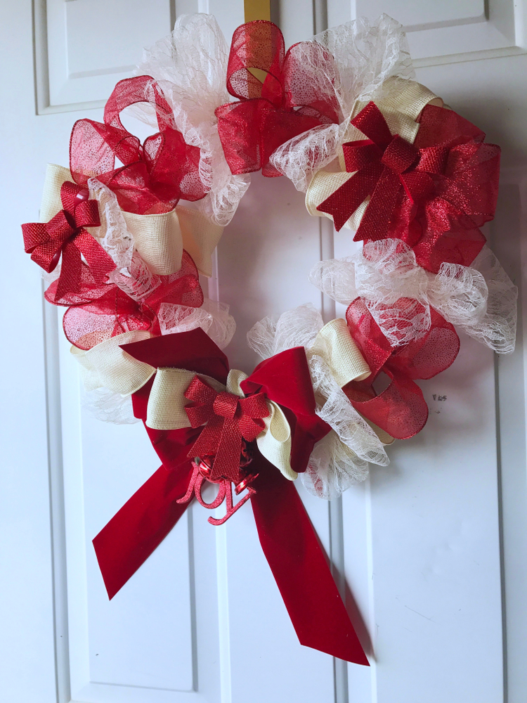 You don't have to spend a bunch of money to make your own decorations. These dollar store Valentine's Day decor ideas are amazing! You can make this wreath for practically nothing.