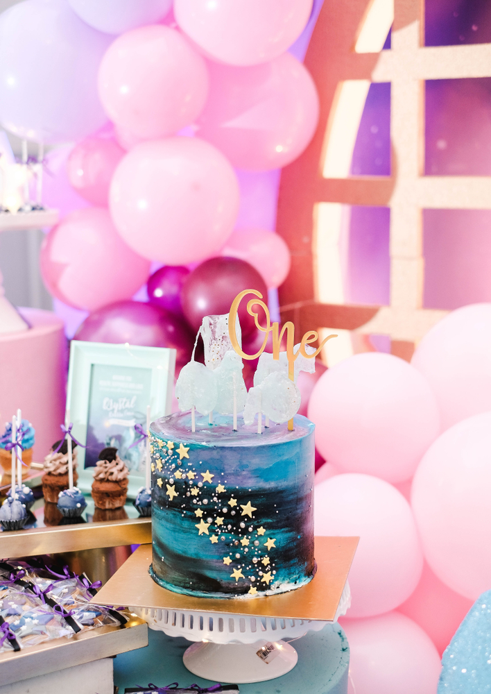 Since we are venturing into the unknown with our party planning ideas, I figured that planning a Galaxy themed birthday party was a must. This is a great party theme for little kids, boys, girls, teens, and adults because it's so incredibly versatile. Look how cute this galaxy themed birthday party is for a one year old!